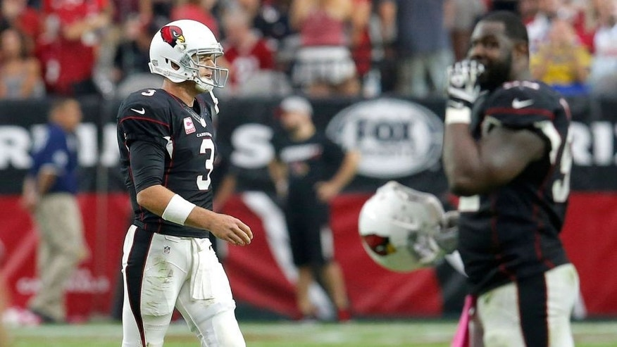 Arizona Cardinals quarterback Carson Palmer (3) walks off the field after an NFL football game against the St. Louis Rams, Sunday, Oct. 4, 2015, in Glendale, Ariz. The Rams won 24-22. (AP Photo/Rick Scuteri)