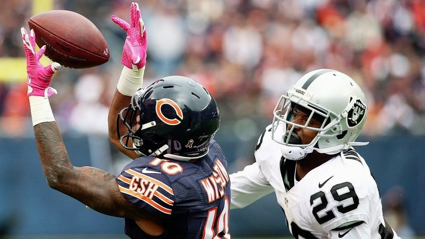 CHICAGO, IL - OCTOBER 04: Marquess Wilson #10 of the Chicago Bears hauls in a pass on the last Bears possession of the game in front of David Amerson #29 of the Oakland Raiders at Soldier Field on October 4, 2015 in Chicago, Illinois. The Bears defeated the Raiders 22-20. (Photo by Jonathan Daniel/Getty Images)