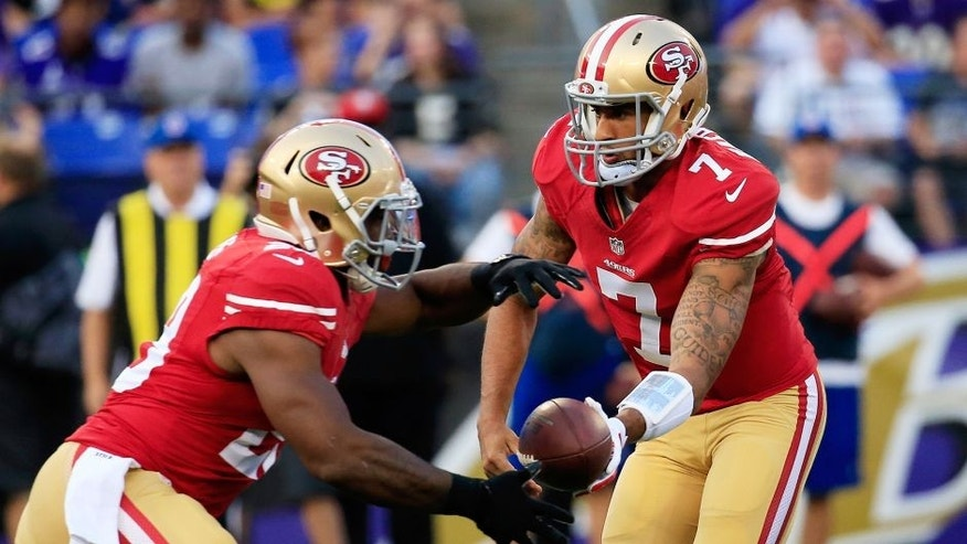"<p style=""font-family: tahoma, arial, helvetica, sans-serif; font-size: 12px;"">AUGUST 07: Quarterback Colin Kaepernick #7 of the San Francisco 49ers hands the ball off to running back Carlos Hyde #28 during the first half of an NFL pre-season game against the Baltimore Ravens at M&T Bank Stadium on August 7, 2014 in Baltimore, Maryland. (Photo by Rob Carr/Getty Images)</p>"