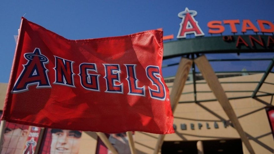 <p>ANAHEIM, CA - JUNE 16: A detailed view of a Los Angeles Angels of Anaheim flag flying outside the stadium before the game against the Arizona Diamondbacks at Angel Stadium of Anaheim on June 16, 2015 in Anaheim, California. (Photo by Josh Barber/Angels Baseball LP/Getty Images)</p>