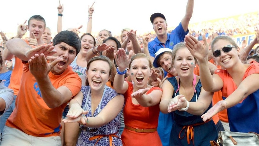 Oct 6, 2012; Gainesville, FL, USA; Florida Gators fans do the gator chomp during the fourth quarter against the LSU Tigers at Ben Hill Griffin Stadium. Mandatory Credit: Jake Roth-USA TODAY Sports