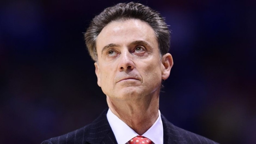 Mar 28, 2014; Indianapolis, IN, USA; Louisville Cardinals head coach Rick Pitino in the first half in the semifinals of the midwest regional of the 2014 NCAA Mens Basketball Championship tournament against the Kentucky Wildcats at Lucas Oil Stadium. Mandatory Credit: Bob Donnan-USA TODAY Sports