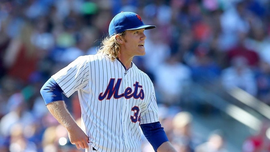NEW YORK, NY - SEPTEMBER 19: Noah Syndergaard #34 of the New York Mets reacts in the sixth inning against the New York Yankees during interleague play on September 19, 2015 at Citi Field in the Flushing neighborhood of the Queens borough of New York City. (Photo by Elsa/Getty Images)