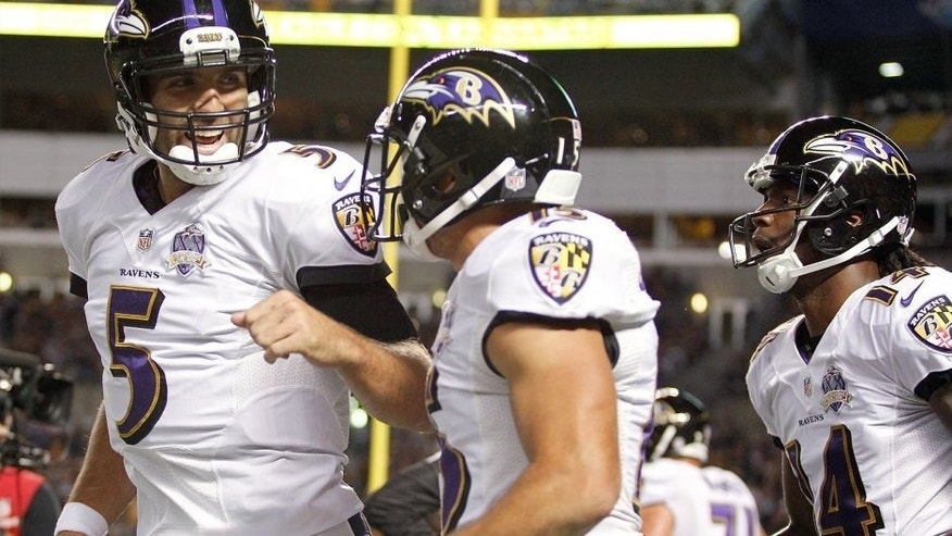 PITTSBURGH, PA - OCTOBER 01: Joe Flacco #5 and Michael Campanaro of the Baltimore Ravens celebrate after Campanaro scored a 1st quarter touchdown during the game against the Pittsburgh Steelers at Heinz Field on October 1, 2015 in Pittsburgh, Pennsylvania. (Photo by Justin K. Aller/Getty Images)