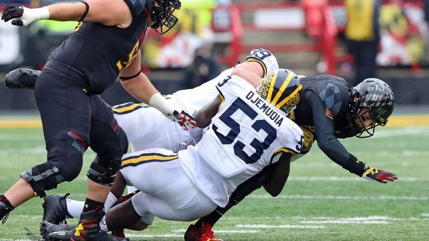 Oct 3, 2015; College Park, MD, USA; Maryland Terrapins quarterback Daxx Garman (18) is sacked by Michigan Wolverines defensive end Mario Ojemudia (53) at Byrd Stadium. Mandatory Credit: Mitch Stringer-USA TODAY Sports