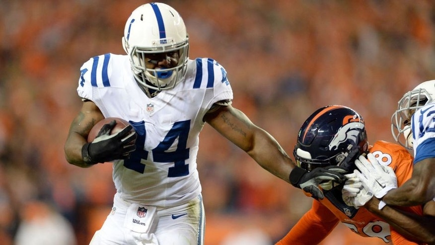 Sep 7, 2014; Denver, CO, USA; Indianapolis Colts running back Ahmad Bradshaw (44) stiff arms Denver Broncos outside linebacker Von Miller (58) in the third quarter at Sports Authority Field at Mile High. The Broncos defeated the Colts 31-24. Mandatory Credit: Ron Chenoy-USA TODAY Sports