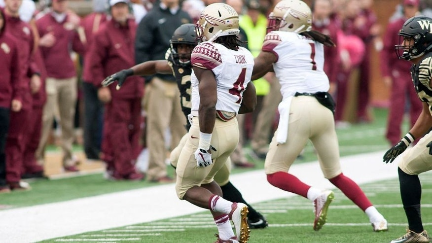 Oct 3, 2015; Winston-Salem, NC, USA; Florida State Seminoles running back Dalvin Cook (4) holds the back of his leg and limps towards the sidelines during a play in the first quarter against the Wake Forest Demon Deacons at BB&T Field. Mandatory Credit: Jeremy Brevard-USA TODAY Sports