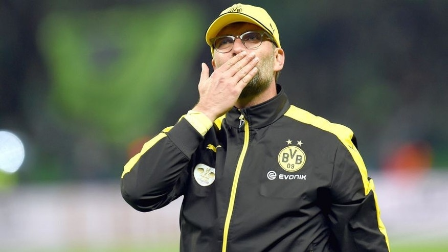 Dortmund's head coach Juergen Klopp gestures after the German Cup DFB Pokal final football match between BVB Borussia Dortmund and VfL Wolfsburg at the Olympic Stadium in Berlin on May 30, 2015. Dortmund lost 1:3. AFP PHOTO / PATRIK STOLLARZ (Photo credit should read PATRIK STOLLARZ/AFP/Getty Images)
