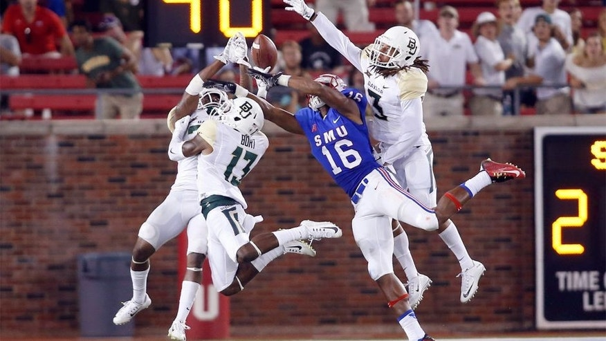 Sep 4, 2015; Dallas, TX, USA; Southern Methodist Mustangs wide receiver Courtland Sutton (16) cannot catch a pass while defended by Baylor Bears safety Terrell Burt (13) and safety J.W. Ketchum (25) and cornerback Tion Wright (3) in the fourth quarter at Gerald J. Ford Stadium. Baylor won 56-21. Mandatory Credit: Tim Heitman-USA TODAY Sports