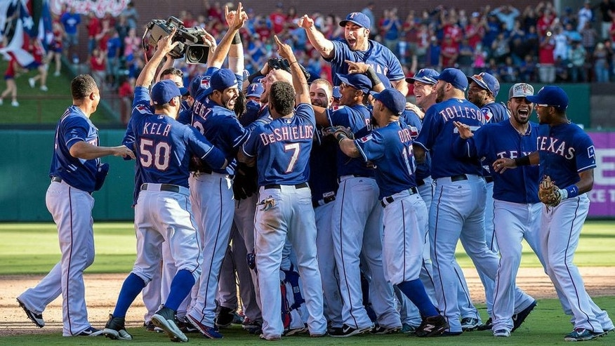 Oct 4, 2015; Arlington, TX, USA; The Texas Rangers celebrate their win over the Los Angeles Angels at Globe Life Park in Arlington. The Texas Rangers defeat the Angels 9-2 and clinch the American League West division. Mandatory Credit: Jerome Miron-USA TODAY Sports