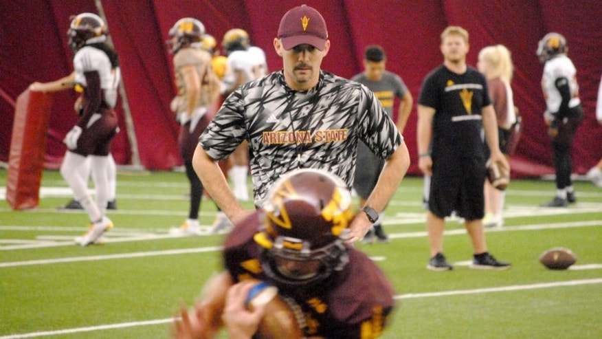 ASU offensive coordinator Mike Norvell watches the running backs in ball protection drill inside the Verde Dickey Dome on October 6, 2015 in Tempe.