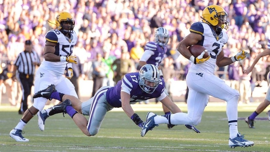 Oct 26, 2013; Manhattan, KS, USA; Kansas State Wildcats defensive back Weston Hiebert (17) misses a tackle on West Virginia Mountaineers running back Charles Sims (3) during the second half at Bill Snyder Family Stadium. The Wildcats defeat the Mountaineers 35-12. Mandatory Credit: Jasen Vinlove-USA TODAY Sports