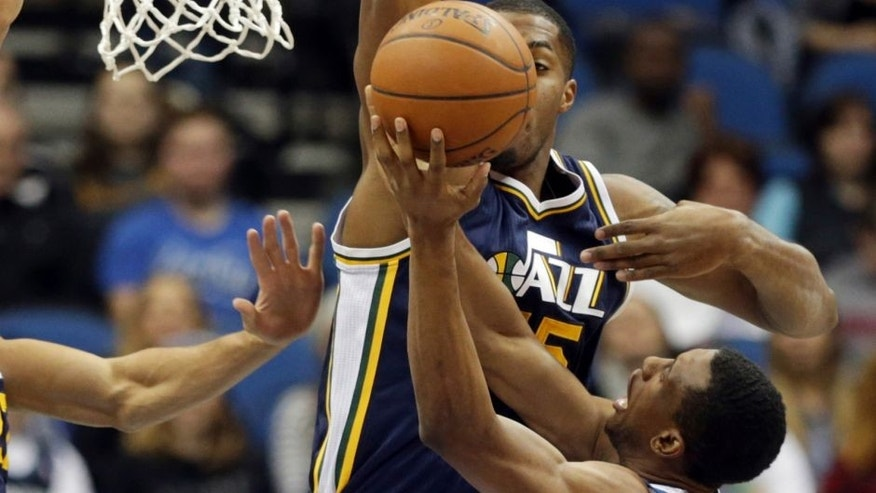 <p>Minnesota Timberwolves' Thaddeus Young, right, attempts a shot as Utah Jazz's Derrick Favors hovers over him in the first quarter of an NBA basketball game, Saturday, Jan. 3, 2015, in Minneapolis. (AP Photo/Jim Mone),Minnesota Timberwolves' Thaddeus Young, right, attempts a shot as Utah Jazz's Derrick Favors hovers over him in the first quarter of an NBA basketball game, Saturday, Jan. 3, 2015, in Minneapolis. (AP Photo/Jim Mone)</p>