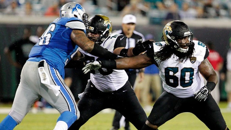Aug 28, 2015; Jacksonville, FL, USA; Jacksonville Jaguars offensive guard A.J. Cann (60) defends during the second half of an NFL preseason football game against the Detroit Lions at EverBank Field. The Lions won 22-17. Mandatory Credit: Reinhold Matay-USA TODAY Sports