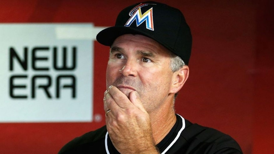 PHOENIX, AZ - JULY 21: Manager Dan Jennings #26 of the Miami Marlins watches from the dugout during the MLB game against the Arizona Diamondbacks at Chase Field on July 21, 2015 in Phoenix, Arizona. (Photo by Christian Petersen/Getty Images)