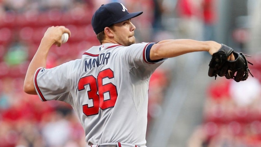 Aug 22, 2014; Cincinnati, OH, USA; Atlanta Braves starting pitcher Mike Minor (36) pitches during the first inning against the Cincinnati Reds at Great American Ball Park. Mandatory Credit: Frank Victores-USA TODAY Sports