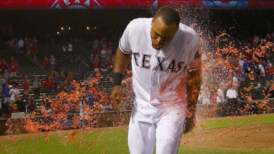 ARLINGTON, TX - SEPTEMBER 29: Adrian Beltre #29 of the Texas Rangers is soaked with PowerAid after the Rangers beat the Detroit Tigers 7-6 at Globe Life Park in Arlington on September 29, 2015 in Arlington, Texas. (Photo by Tom Pennington/Getty Images)