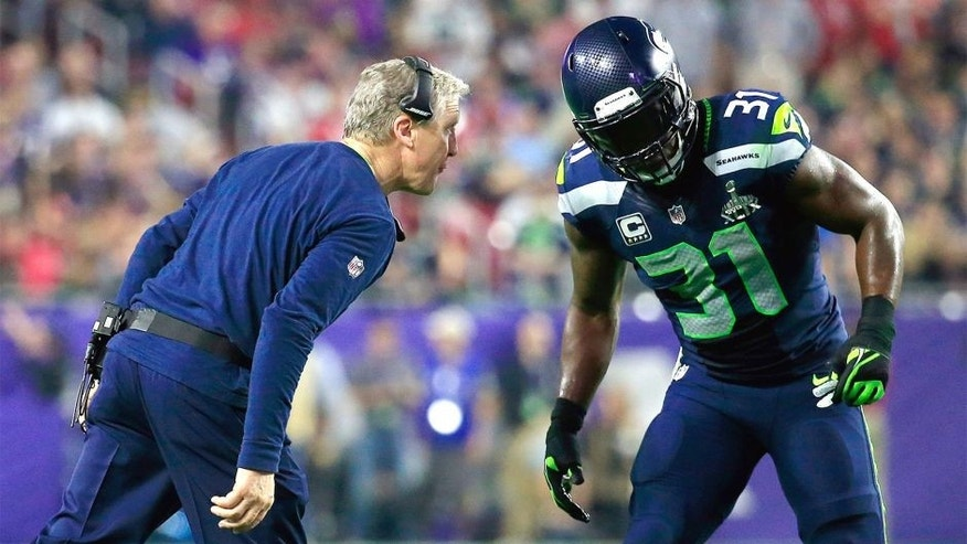 GLENDALE, AZ - FEBRUARY 01: Head coach Pete Carroll of the Seattle Seahawks speaks to Kam Chancellor #31 in the second half against the New England Patriots during Super Bowl XLIX at University of Phoenix Stadium on February 1, 2015 in Glendale, Arizona. (Photo by Rob Carr/Getty Images)