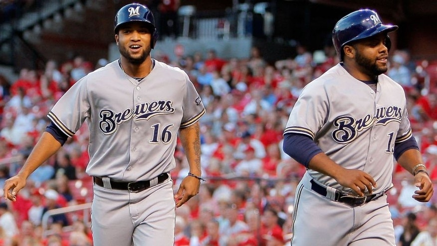 <p>Sep 24, 2015; St. Louis, MO, USA; Milwaukee Brewers center fielder Domingo Santana (16) and first baseman Jason Rogers (15) head for the dugout after scoring runs on a double by Hernan Perez during the first inning of a baseball game against the St. Louis Cardinals at Busch Stadium. Mandatory Credit: Scott Kane-USA TODAY Sports</p>