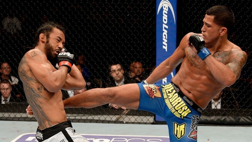 MILWAUKEE, WI - AUGUST 31: (R-L) Anthony 'Showtime' Pettis kicks Benson Henderson in their UFC lightweight championship bout at BMO Harris Bradley Center on August 31, 2013 in Milwaukee, Wisconsin. (Photo by Jeff Bottari/Zuffa LLC/Zuffa LLC via Getty Images)