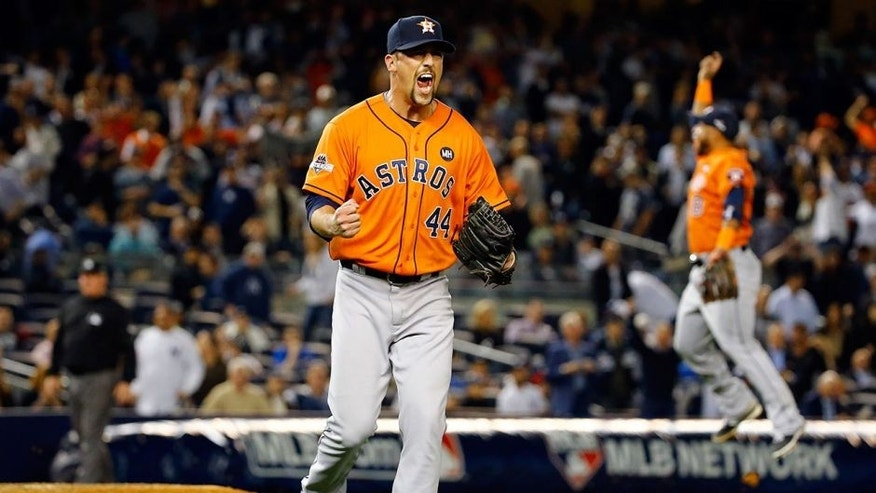 NEW YORK, NY - OCTOBER 06: Luke Gregerson #44 of the Houston Astros celebrates defeating the New York Yankees in the American League Wild Card Game at Yankee Stadium on October 6, 2015 in New York City. The Astros defeated the Yankees with a score of 3 to 0. (Photo by Al Bello/Getty Images)