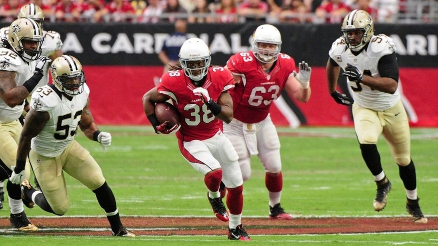 Sep 13, 2015; Glendale, AZ, USA; Arizona Cardinals running back Andre Ellington (38) carries the ball during the first half against the Arizona Cardinals at University of Phoenix Stadium. Mandatory Credit: Matt Kartozian-USA TODAY Sports