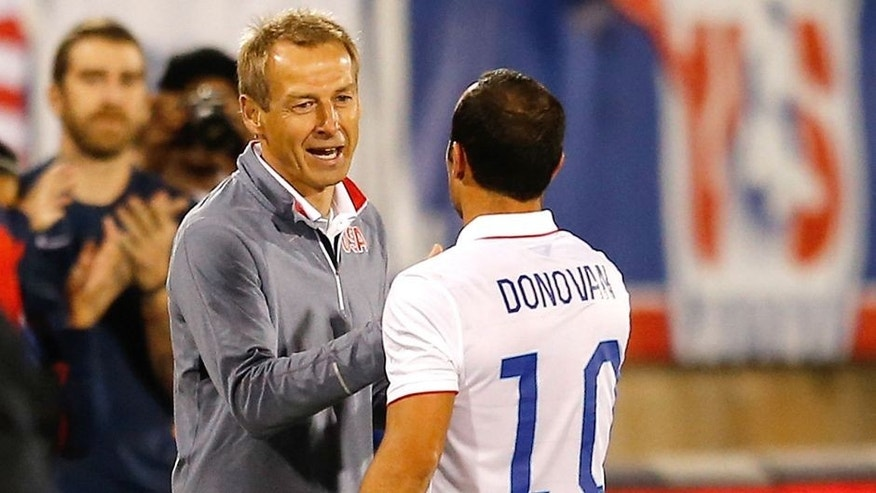 EAST HARTFORD, CT- OCTOBER 10: Landon Donovan #10 of the United States shakes hands head coach Jurgen Klinsmann as he leaves the field after playing in the first half during an international friendly with Ecuador at Rentschler Field on October 10, 2014 in East Hartford, Connecticut. (Photo by Jim Rogash/Getty Images)