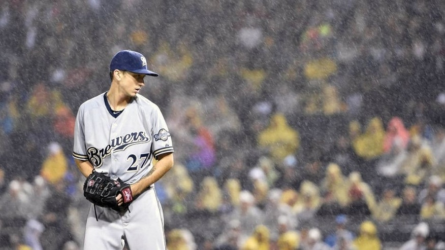 Saturday, Sept. 12, 2015: Milwaukee Brewers pitcher Zach Davies gets set to throw against the Pittsburgh Pirates during a rain storm in the third inning of in Pittsburgh.