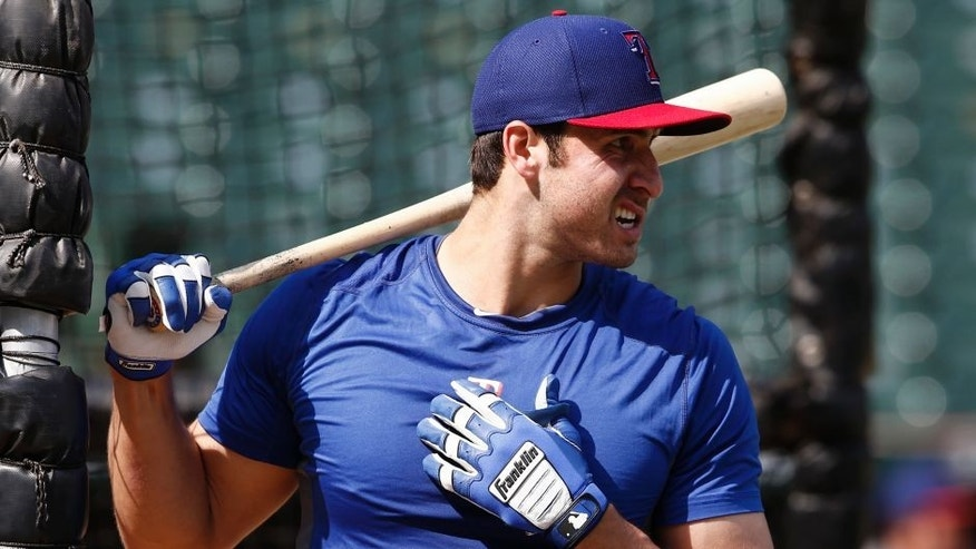 Texas Rangers' Joey Gallo watches during batting practice before the Rangers' baseball game against the Chicago White Sox on Tuesday, June 2, 2015, in Arlington, Texas. (AP Photo/Jim Cowsert)