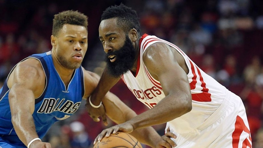 Oct 7, 2015; Houston, TX, USA; Houston Rockets guard James Harden (13) dribbles against Dallas Mavericks guard Justin Anderson (1) in the first quarter at Toyota Center. Mandatory Credit: Thomas B. Shea-USA TODAY Sports