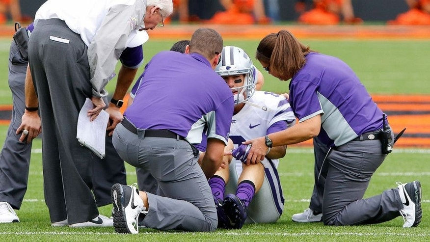 Oct 3, 2015; Stillwater, OK, USA; Kansas State Wildcats quarterback Joe Hubener (8) is looked at by trainers after getting injured in a play against the Oklahoma State Cowboys during the first quarter at Boone Pickens Stadium. Mandatory Credit: Alonzo Adams-USA TODAY Sports
