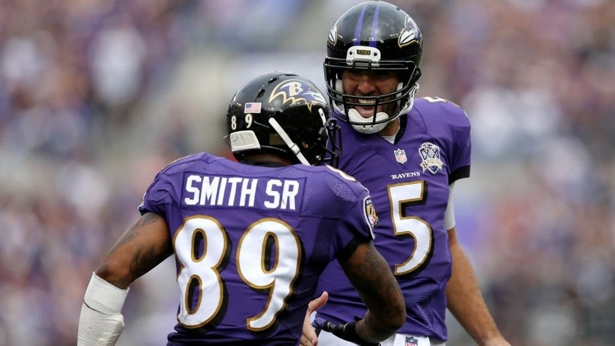 BALTIMORE, MD - SEPTEMBER 27: Wide receiver Steve Smith #89 of the Baltimore Ravens celebrates with quarterback Joe Flacco #5 of the Baltimore Ravens after scoring a fourth quarter touchdown during a game against the Cincinnati Bengals at M&T Bank Stadium on September 27, 2015 in Baltimore, Maryland. (Photo by Patrick Smith/Getty Images)