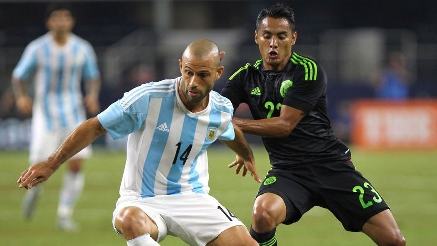 ARLINGTON, UNITED STATES - SEPTEMBER 08: Javier Mascherano of Argentina controls the ball as José Juan Vázquez defends during a friendly match between Argentina and Mexico at AT&T Stadium on September 08, 2015 in Arlington, United States. (Photo by Omar Vega/LatinContent/Getty Images)