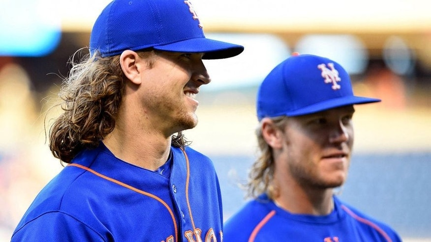 Aug 27, 2015; Philadelphia, PA, USA; New York Mets starting pitcher Jacob deGrom (48) and starting pitcher Noah Syndergaard (34) walk toward the dugout before game against the Philadelphia Phillies at Citizens Bank Park. The Mets defeated the Phillies, 9-5 in 13 innings. Mandatory Credit: Eric Hartline-USA TODAY Sports