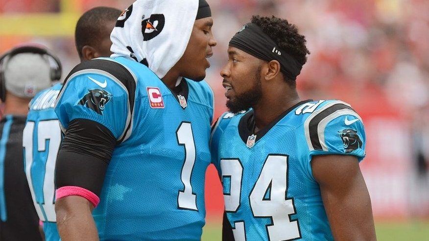 Oct 4, 2015; Tampa, FL, USA; Carolina Panthers defensive back Josh Norman (24) celebrates with Carolina Panthers quarterback Cam Newton (1) after a interception return for touchdown in the first half against the Tampa Bay Buccaneers at Raymond James Stadium. Mandatory Credit: Jonathan Dyer-USA TODAY Sports