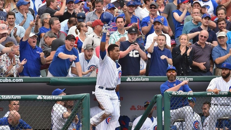 Sep 19, 2015; Chicago, IL, USA; Chicago Cubs shortstop Starlin Castro (13) waives to the fans after hitting his second home run of the game against the St. Louis Cardinals at Wrigley Field. Mandatory Credit: Jasen Vinlove-USA TODAY Sports