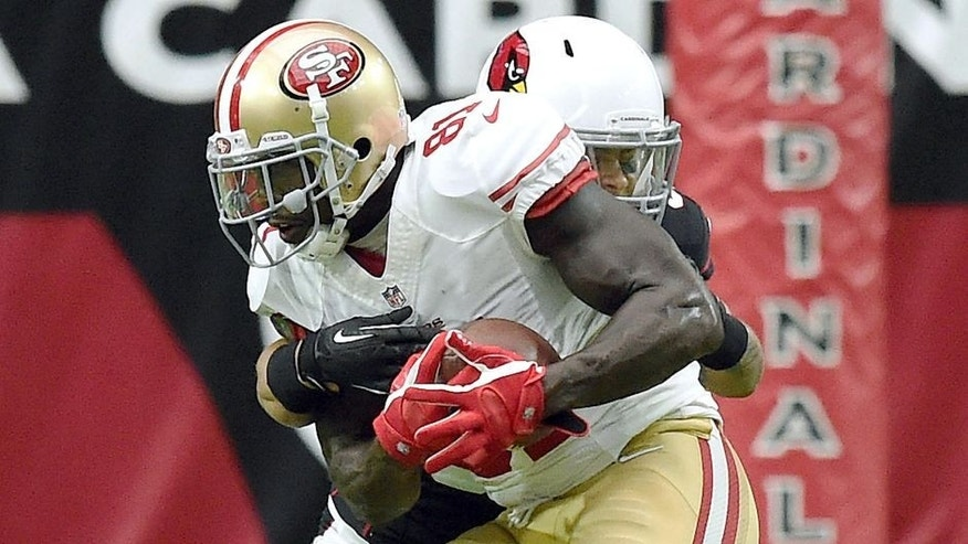 GLENDALE, AZ - SEPTEMBER 21: Wide receiver Anquan Boldin #81 of the San Francisco 49ers is hit by safety Tyrann Mathieu #32 of the Arizona Cardinals during the second quarter of the NFL game at University of Phoenix Stadium on September 21, 2014 in Glendale, Arizona. (Photo by Norm Hall/Getty Images)