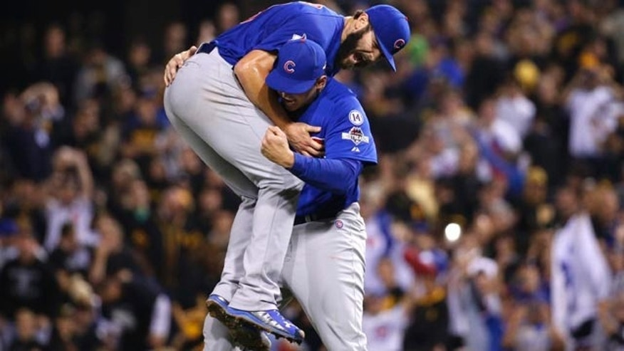 Oct. 7, 2015: Chicago Cubs first baseman Anthony Rizzo, right, holds Chicago Cubs starting pitcher Jake Arrieta after they defeated the Pittsburgh Pirates in the National League wild card baseball game 4-0 in Pittsburgh. The Cubs advance to play the St. Louis Cardinals in the National League Division Series.(AP Photo/Gene J. Puskar)