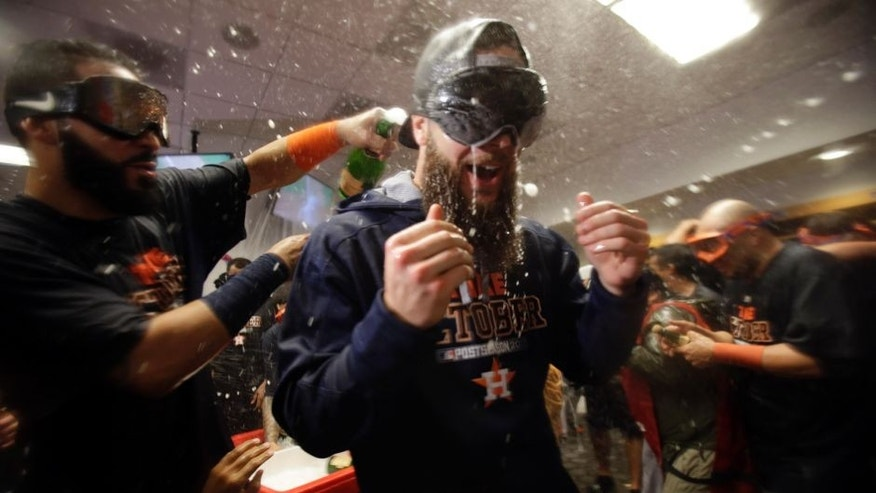 Oct 6, 2015; Bronx, NY, USA; Houston Astros starting pitcher Dallas Keuchel (right) celebrates with teammates in the locker room after defeating the New York Yankees in the American League Wild Card playoff baseball game at Yankee Stadium. Houston won 3-0. Mandatory Credit: Adam Hunger-USA TODAY Sports