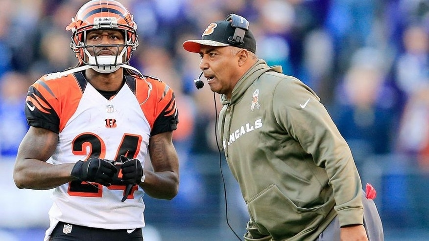 BALTIMORE, MD - NOVEMBER 10: Head coach Marvin Lewis of the Cincinnati Bengals talks with Adam Jones #24 during the fourth quarter against the Baltimore Ravens at M&T Bank Stadium on November 10, 2013 in Baltimore, Maryland. (Photo by Rob Carr/Getty Images) *** Local Caption *** Marvin Lewis; Adam Jones