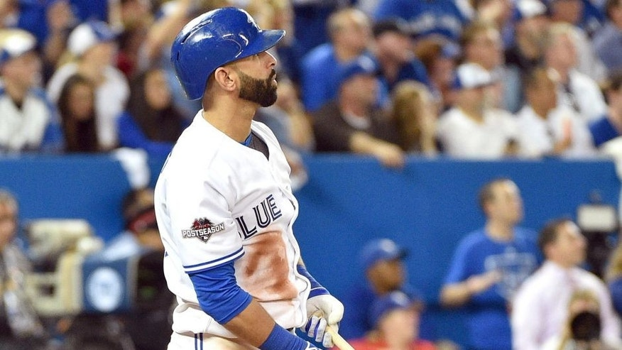 Oct 8, 2015; Toronto, Ontario, CAN; Toronto Blue Jays right fielder Jose Bautista hits a solo home run against the Texas Rangers in the sixth inning in game one of the ALDS at Rogers Centre. Mandatory Credit: Nick Turchiaro-USA TODAY Sports
