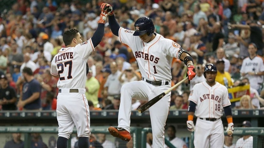 Jun 29, 2015; Houston, TX, USA; Houston Astros shortstop Carlos Correa (1) celebrates with second baseman Jose Altuve (27) after a home-run against the Kansas City Royals in the third inning at Minute Maid Park. Mandatory Credit: Thomas B. Shea-USA TODAY Sports
