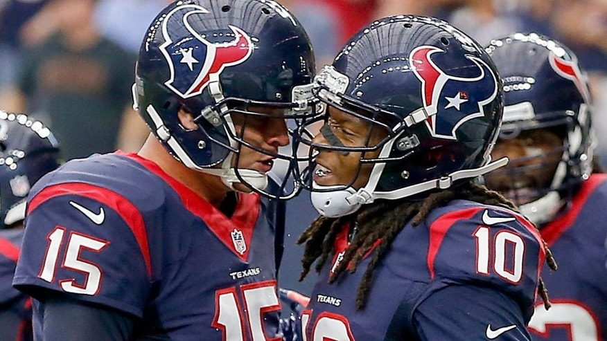 HOUSTON, TX - SEPTEMBER 27: Ryan Mallett #15 of the Houston Texans and DeAndre Hopkins #10 celebrate after a touchdown in the first quarter at NRG Stadium on September 27, 2015 in Houston, Texas. (Photo by Bob Levey/Getty Images)