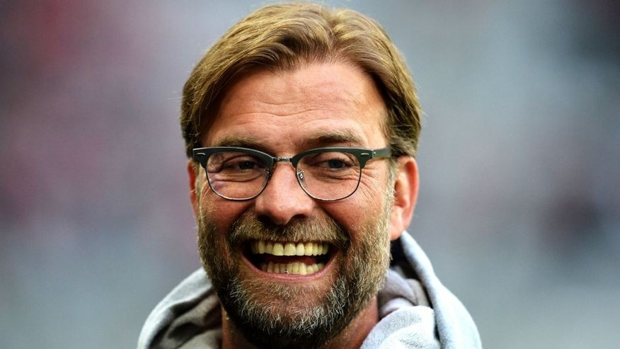 MUNICH, GERMANY - APRIL 28: Juergen Klopp head coach of Dortmund looks happy prior to thr start of the DFB Cup semi final match between FC Bayern Muenchen and Borussia Dortmund at Allianz Arena on April 28, 2015 in Munich, Germany. (Photo by Matthias Hangst/Bongarts/Getty Images)