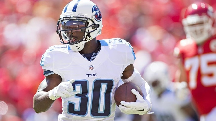 KANSAS CITY, MO - SEPTEMBER 7: Jason McCourty #30 of the Tennessee Titans runs the ball during a game against the Kansas City Chiefs at Arrowhead Stadium on September 7, 2014 in Kansas City, Missouri. The Titans defeated the Chiefs 26-10. (Photo by Wesley Hitt/Getty Images)