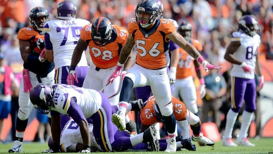 Oct 4, 2015; Denver, CO, USA; Denver Broncos linebacker Shane Ray (56) celebrates his sack in the first quarter against the Minnesota Vikings at Sports Authority Field at Mile High. Mandatory Credit: Ron Chenoy-USA TODAY Sports