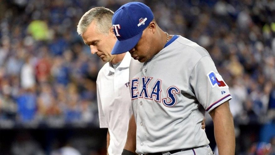 Oct 8, 2015; Toronto, Ontario, CAN; Texas Rangers third baseman Adrian Beltre is helped off the field in the third inning after an injury sustained against the Toronto Blue Jays in game one of the ALDS at Rogers Centre. Mandatory Credit: Nick Turchiaro-USA TODAY Sports