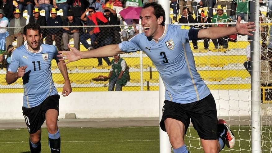 Uruguay's defender Diego Godin (R) celebrates after scoring against Bolivia during the Russia 2018 FIFA World Cup qualifiers match, at the Hernando Siles stadium in La Paz, on October 8, 2015. AFP PHOTO / AIZAR RALDES (Photo credit should read AIZAR RALDES/AFP/Getty Images)