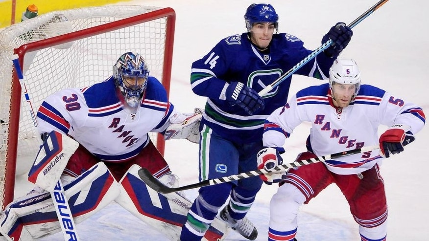 Dec 13, 2014; Vancouver, British Columbia, CAN; Vancouver Canucks forward Alexandre Burrows (14) gets between New York Rangers goaltender Henrik Lundqvist (30) and defenseman Dan Girardi (5) during the third period at Rogers Arena. The New York Rangers won 5-1. Mandatory Credit: Anne-Marie Sorvin-USA TODAY Sports