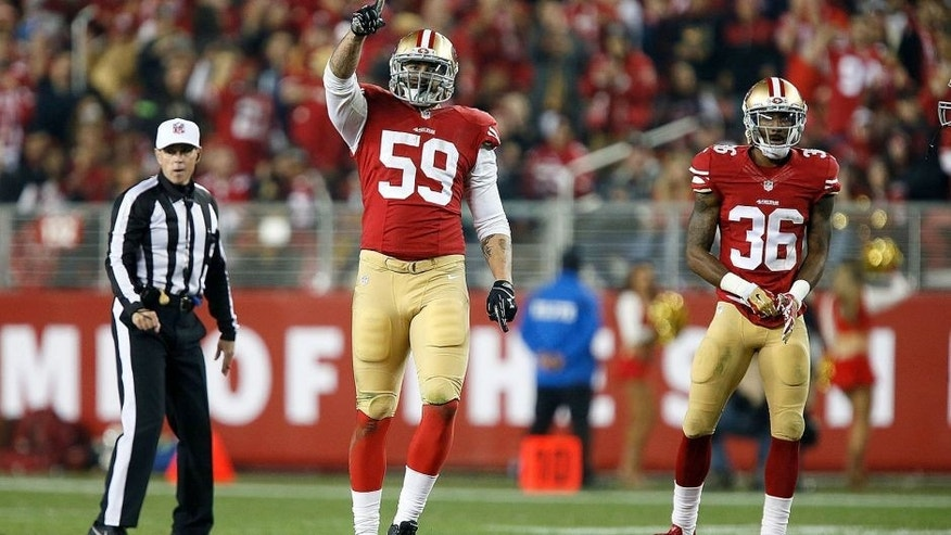 SANTA CLARA, CA - NOVEMBER 27: Aaron Lynch #59 of the San Francisco 49ers celebrates after a sack against the Seattle Seahawks at Levi's Stadium on November 27, 2014 in Santa Clara, California. (Photo by Brian Bahr/Getty Images)